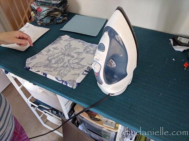 Ironing edges of the fabric.
