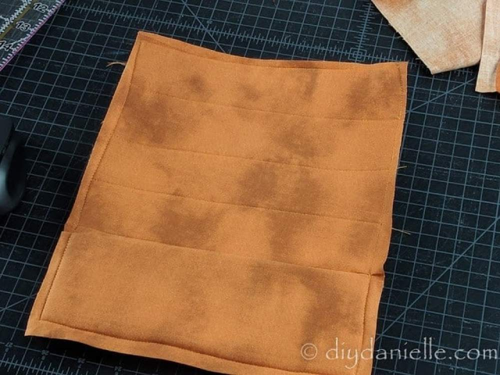 Sew your fabric to your mouse pad, then trim excess fabric.