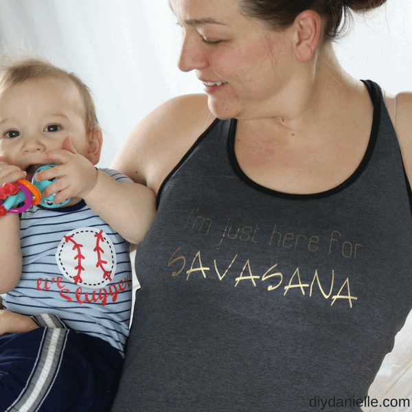 "Mom holding baby, wearing a yoga shirt: ""I'm just here for Savasana."""