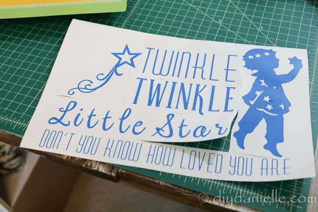 Cricut Outdoor vinyl, weeded and ready to be applied on nursery signs.