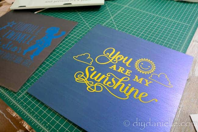 """You are my sunshine"" nursery sign with metallic blue flash paint and yellow outdoor vinyl."