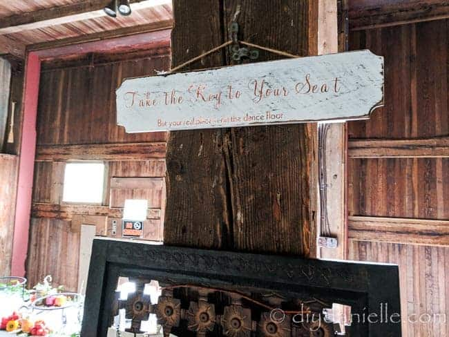 """""""Take the key to your seat: But your real place is on the dance floor"""" sign for a wedding reception. Made with a Cricut cutting machine."""