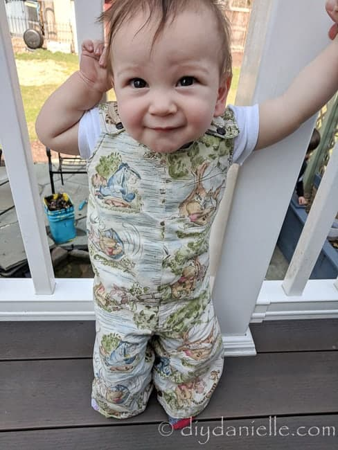 Baby wearing the reversible romper that I made in size 12-18 months. Winnie the Pooh fabric.