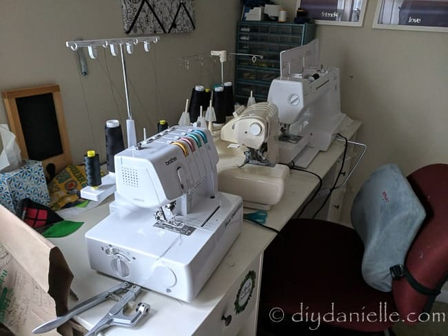 The sewing area without the muffling mat under the serger and other machines.