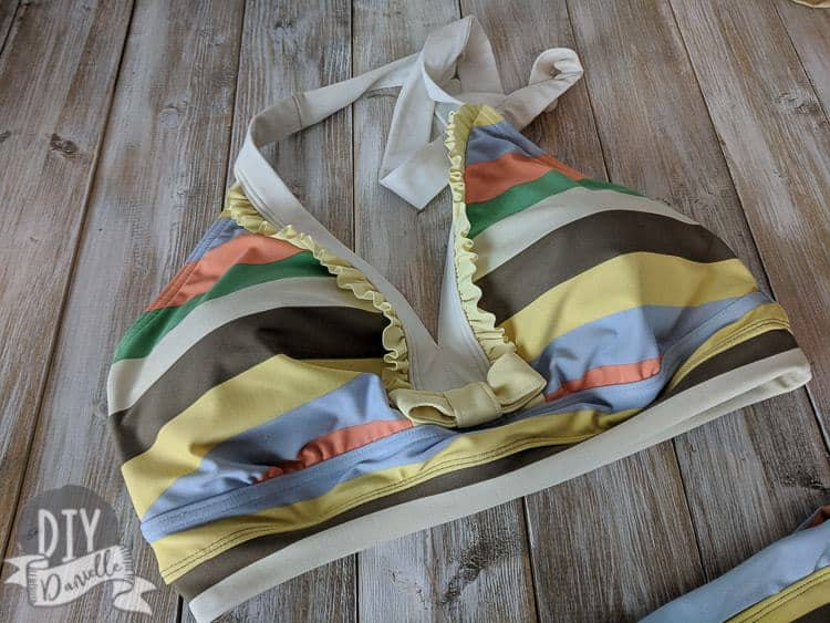 Bikini top with ruffles that ties around neck.