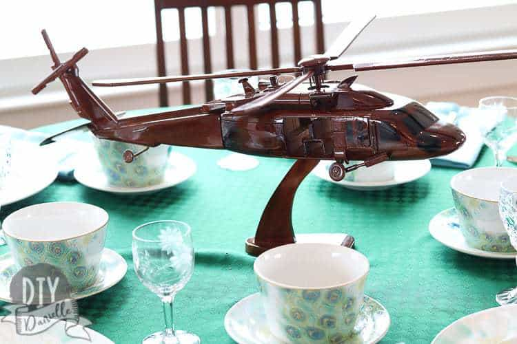 Wood Black Hawk Helicopter replica as a centerpiece on the table.