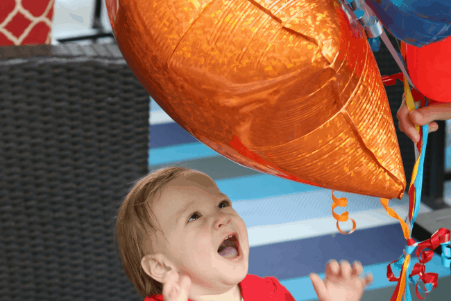 Favor Ideas for Kids Parties: Little Boy Playing with Balloons