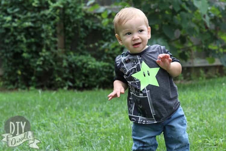 Little boy wearing the Half Pipe T-Shirt. HTV Star on a Mario T-shirt.
