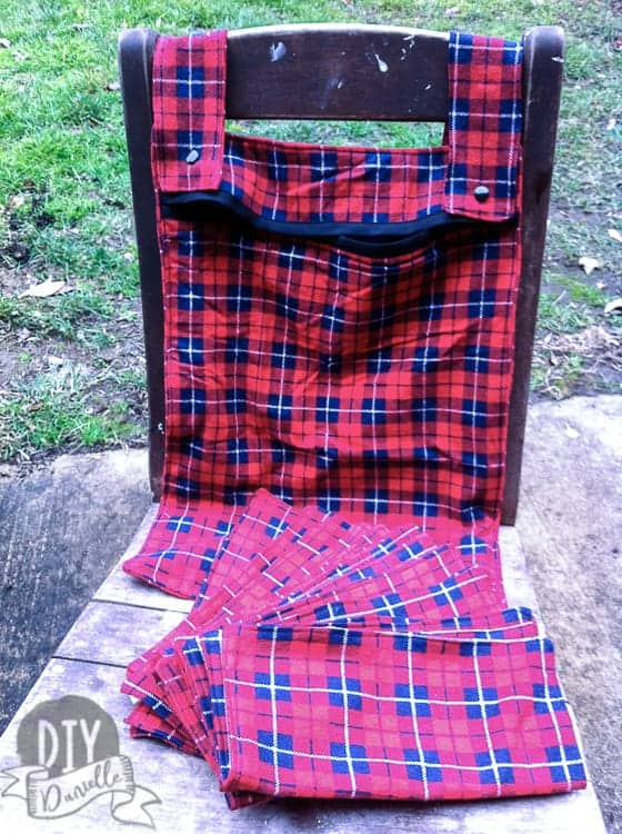 Red and black plaid kitchen wet bag with matching unpaper towels.