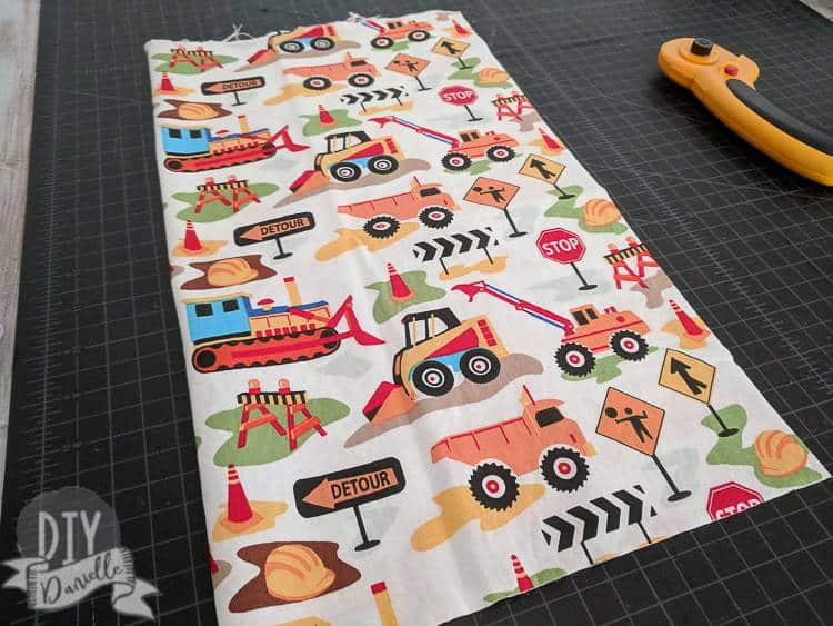 Cutting out fabric for the toy holder.