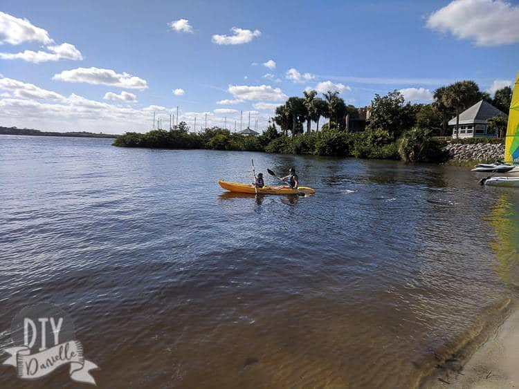 Kayaking with my son at Sandpiper Bay Resort in the river.