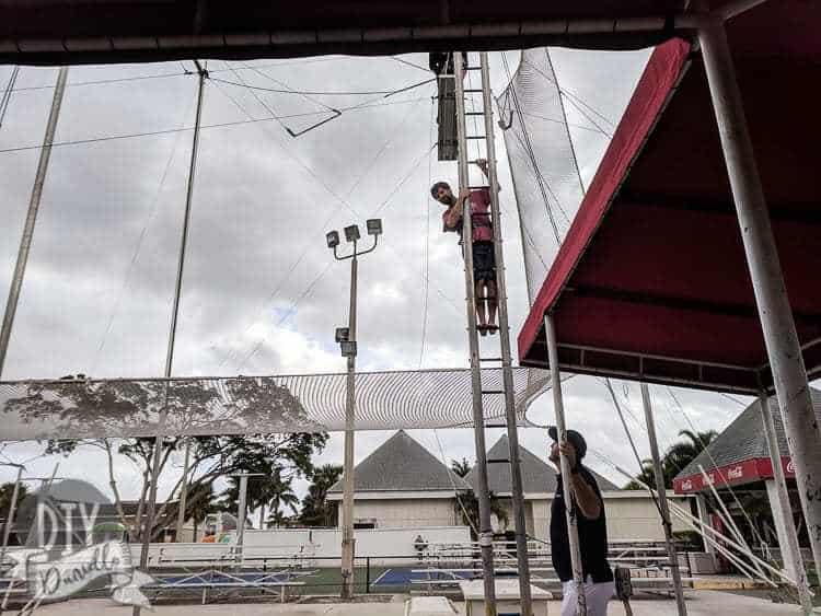 My husband climbing up to do trapeze.