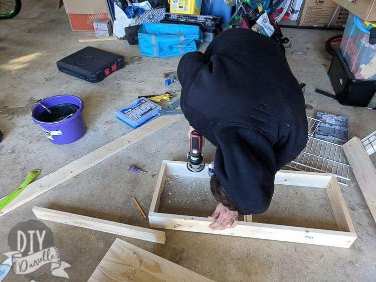 Using a router to create a lip on the frame for the drying rack.