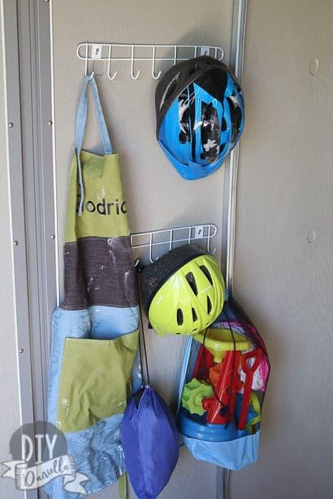 Organizing bike helmets with $1 hooks.
