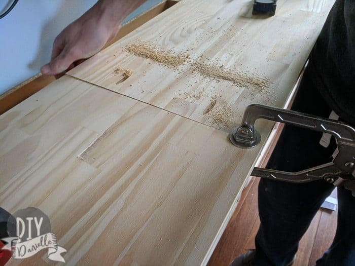 Using pocket screws to attach the cabinet pieces.