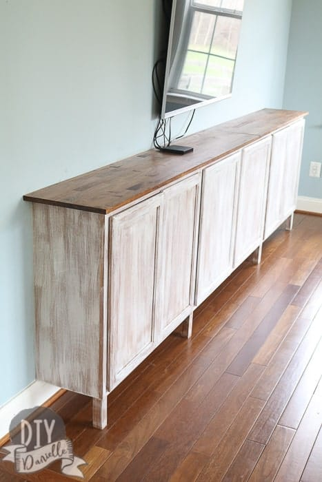 DIY Easy living room storage cabinets. These cabinets are an easy and effective way to add a lot of storage to your living room without purchasing extra furniture.