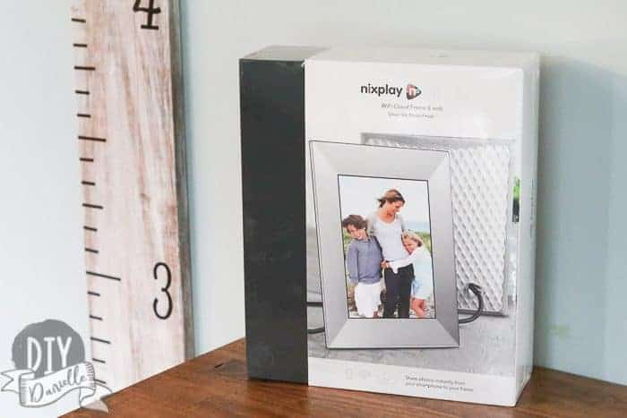 Nix Digital Photo Frame on Family Room Cabinet, still in the box