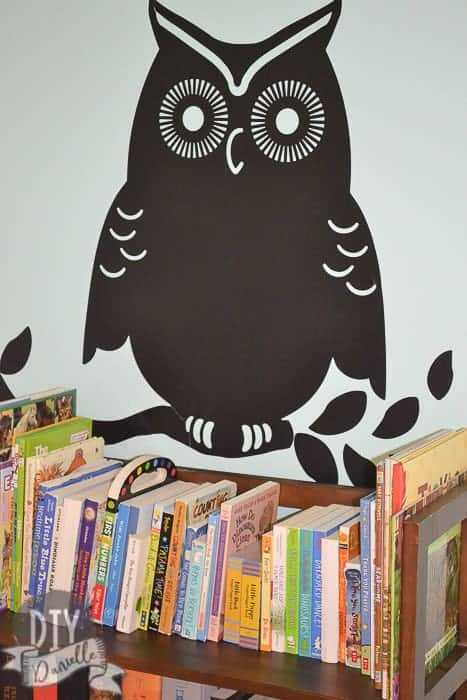 Owl decal above the bookshelves.