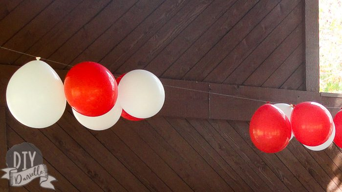 Red and white balloons upside down for Cat in the Hat party.