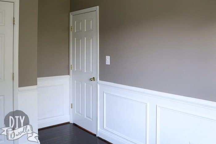 Bedroom photo after: Gray above the chair rail, white from the chair rail to the baseboards.