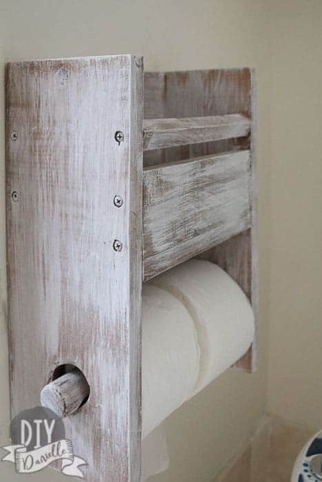 Toilet paper holder for 2 rolls, plus storage above.