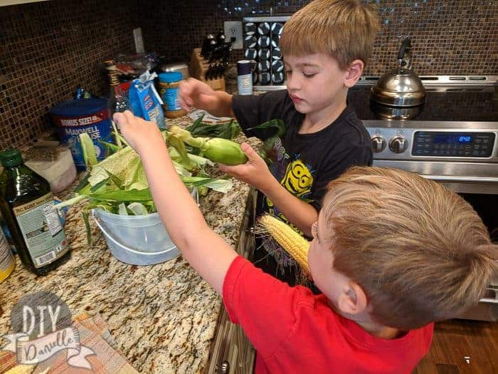Kids helping with corn.