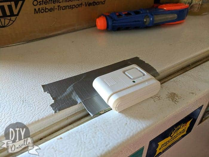 Setting up a $5 alarm for the tall freezer (would also work on a fridge).