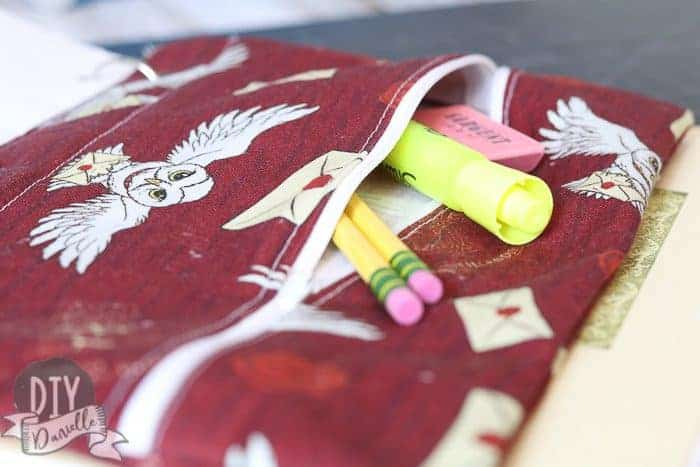 Harry Potter themed DIY Pencil case unzipped with pencils, eraser, and highlighter sticking out.