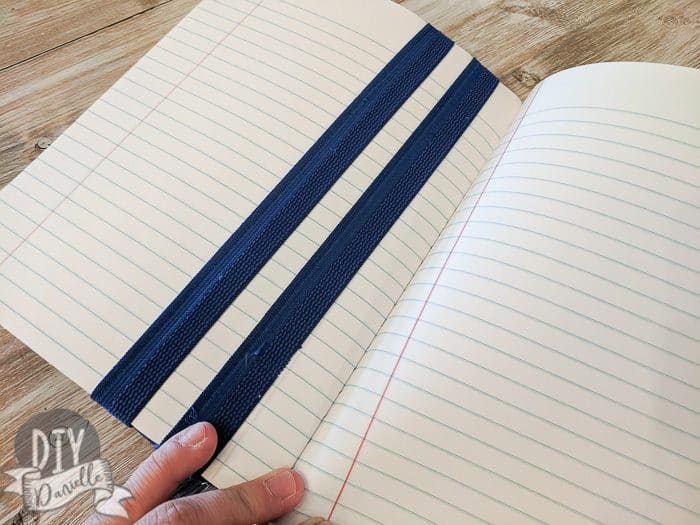 The elastic on the inside of the journal, holding the bookmark in place.