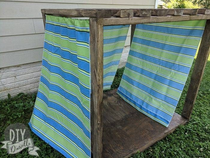 DIY Small Cabana for the backyard for either the kids or the dog, or both. Fabric curtains for the side.