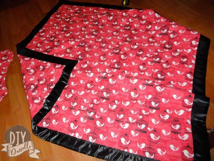 Over sized baby blanket made from flannel with satin binding.