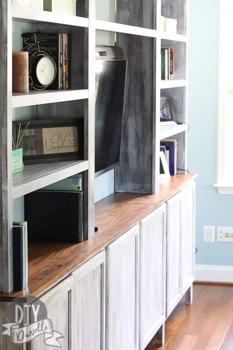 Another angle of the bookshelves. Love these built-ins. They add so much storage space and character to our living room.