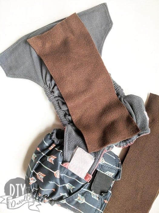 Brown fleece liner on a cloth diaper.