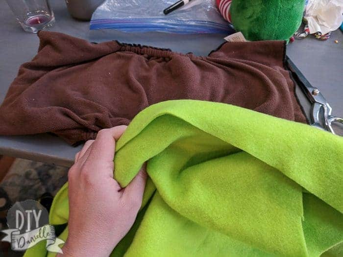 Green fleece for a larger brown cloth diaper.