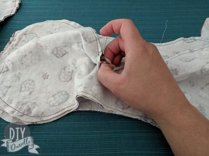 Turning the burp cloths right sides out.