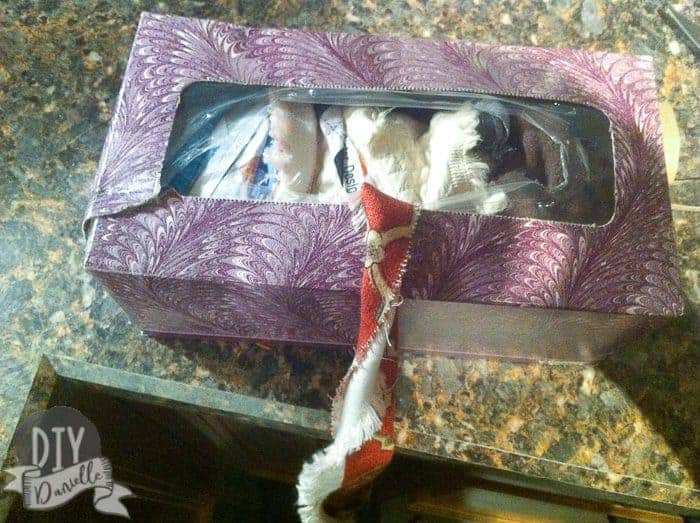 Old kleenex box stuffed with fabric scraps tied together.