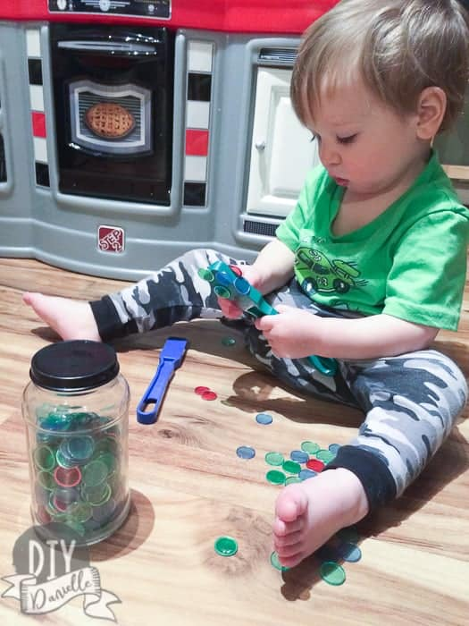 Toddler playing with magnetic Bingo wands.