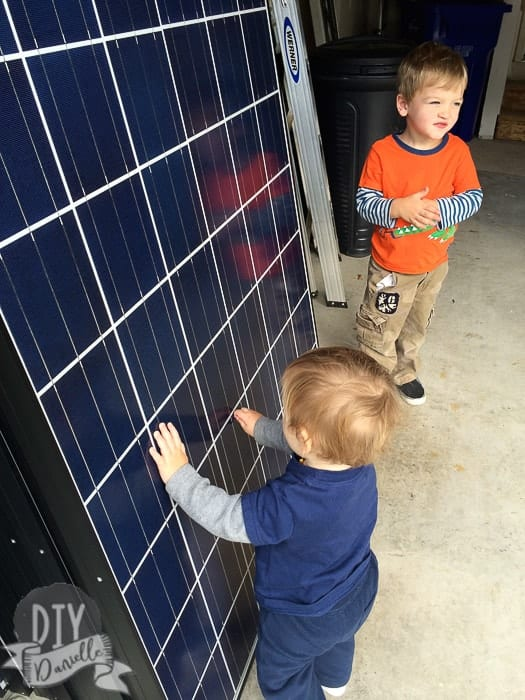 Kids touching the solar panels.