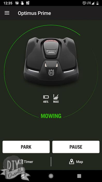 App indicating the mower's charge with options to park or pause it.