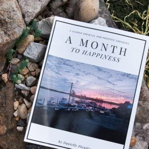 Book in nature setting: A Month to Happiness