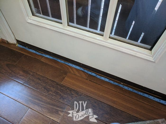 Measuring the door width.