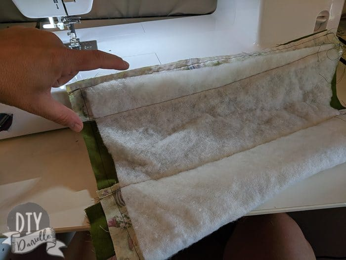Folded the fabric right sides together, sewed the long side and the bottom.