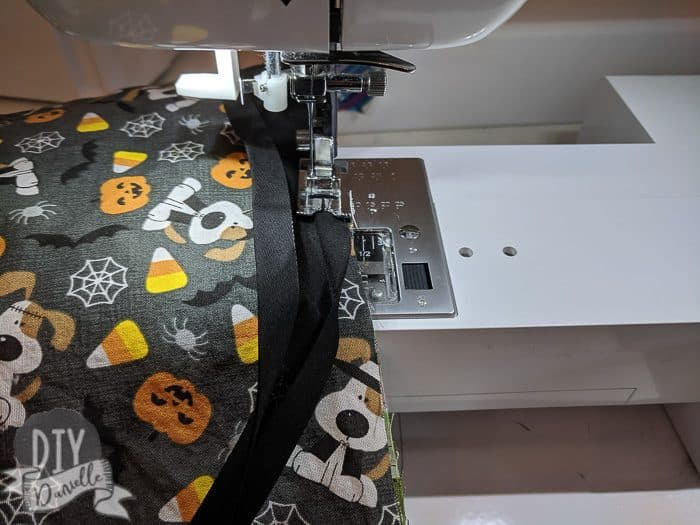 Sewing bias tape on the bags.