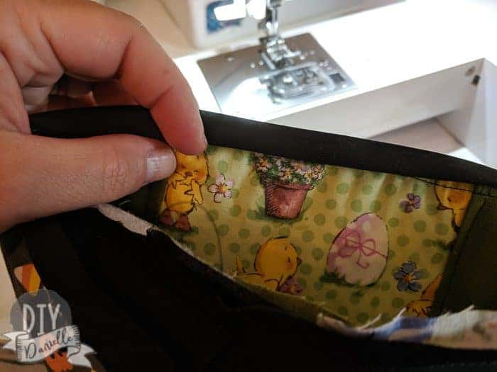 Sewing the bias tape on the reversible bag.