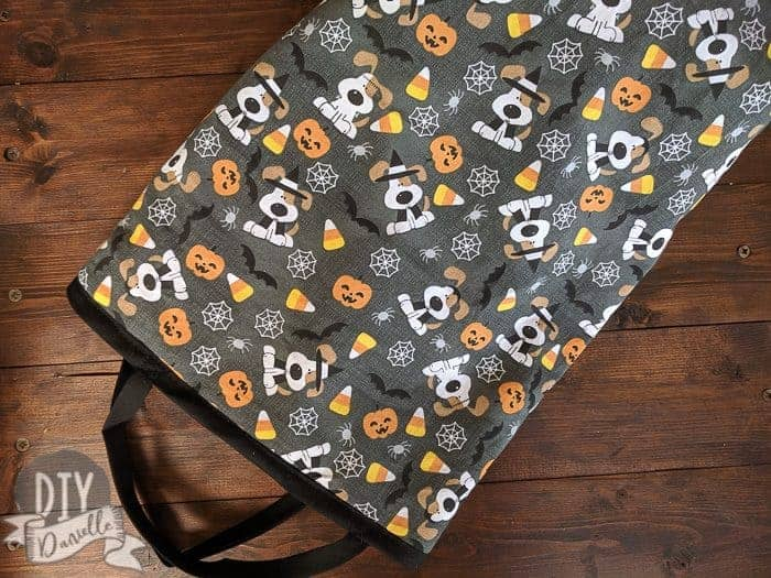 Halloween bag laying on it's side: Puppies, Candy Corn, Spiders & Spider Web Fabric.