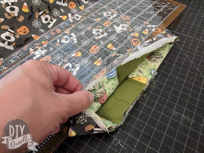 The Easter fabric pieces tucked wrong sides together with the Halloween fabric.