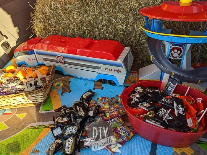Halloween treats in our trunk. There's treats on left that are non edible- like vampire fangs (huge hit), squishy pumpkins, pencils, and erasers.