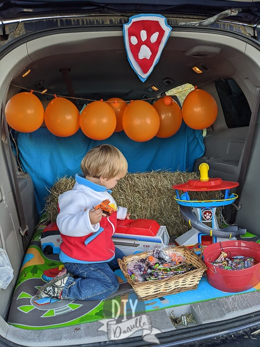 My 2 year old snacking on candy and treats while playing with Paw Patrol toys until the trunk or treat events finished.