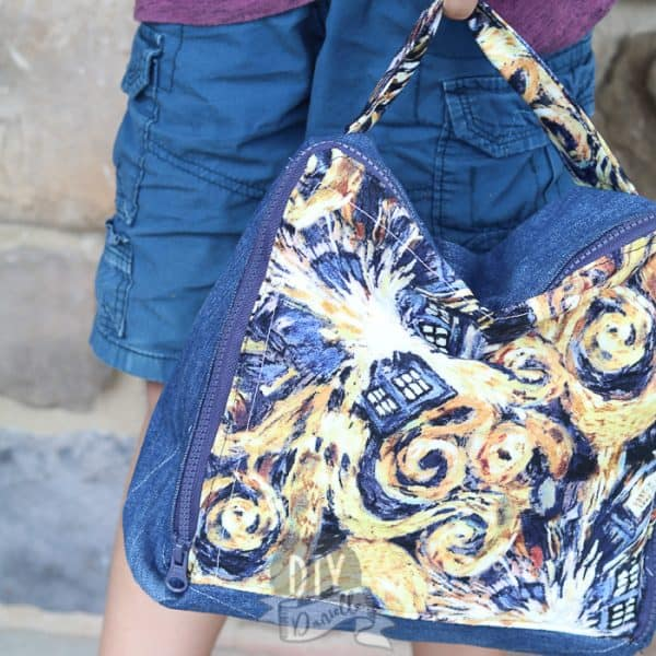 DIY Square Lunch Box held by child. Doctor Who fabric that has the swirls and Tardis.