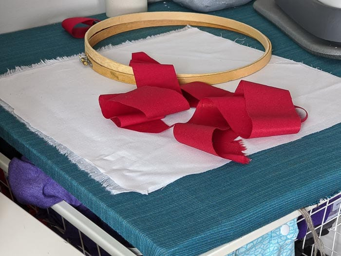 Supplies: Embroidery hoop, red and white fabric.